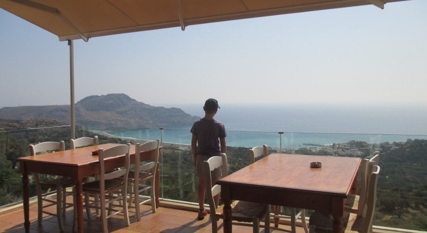 view of sea, hills, and sky from Plateia Taverna in Myrthios, Crete